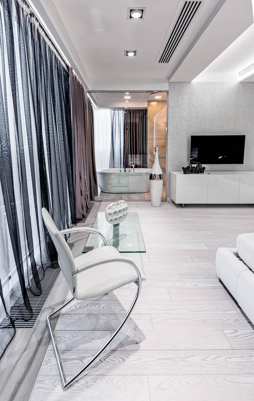 Дизайн интерьера спальни с открытым видом на ванную